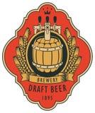 Label pour la bière pression avec le baril et le manteau des bras Images libres de droits