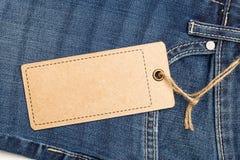 Label price tag mockup on blue jeans. Label price tag mockup on blue jeans from recycled paper Stock Images