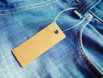 Label price tag mockup on blue jeans. Royalty Free Stock Photo