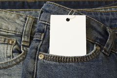 Label price tag mockup on blue jeans from white paper royalty free stock images