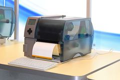 Label printer. For self adhesive stickers in warehouse royalty free stock photo