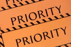 Label priority. Orange-coloured label priority for baggage Royalty Free Stock Image