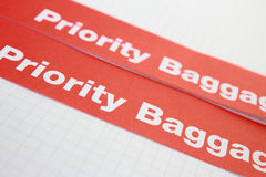 Label priority. Red label priority for baggage Stock Photo