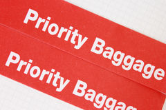 Label priority. Red label priority for baggage Stock Photography