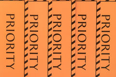 Label priority. Orange-coloured label priority for baggage Royalty Free Stock Images