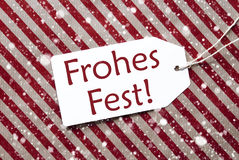 Label On Red Paper, Frohes Fest Means Merry Christmas, Snowflakes Royalty Free Stock Images