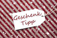 Label, Red Wrapping Paper, Geschenk Tipp Means Gift Tip, Snowflakes Royalty Free Stock Photos