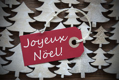 Label rouge avec Joyeux Noel Means Merry Christmas Photographie stock libre de droits