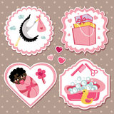 Label set with items for mulatto newborn baby girl. A set of cute cartoon Label with items for mulatto newborn baby girl. Baby cartoon icons,scrapbooking Royalty Free Stock Photo