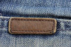 Label sewed on a blue jeans.. Royalty Free Stock Photography