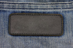 Label sewed on a blue jeans.. Stock Image