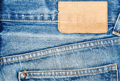 Label sewed on a blue jeans Royalty Free Stock Photos