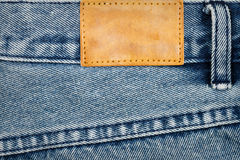 Label sewed on a blue jeans Stock Image