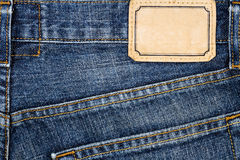 Label sewed on a blue jeans Royalty Free Stock Photography