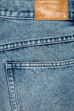 Label sewed on a blue jeans Stock Photography