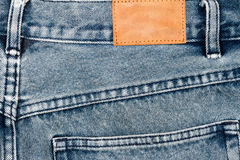 Label sewed on a blue jeans Stock Images