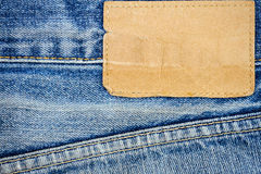 Label sewed on a blue jeans Royalty Free Stock Image