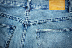 Label sewed on a blue jeans Royalty Free Stock Images