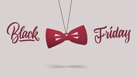 Cardboard red bow tie. black Friday concept. A label in shape of the fashion bow tie made of cardboard on a purple background. calligraphic text is black Friday Royalty Free Stock Photo