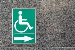 Label sign of cripple. On marble wall Stock Photo
