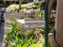 Label sign with the inscription - Winepress - in The Garden Tomb Jerusalem located in East Jerusalem, Israel. Jerusalem, Israel, November 17, 2018 : Label sign stock images