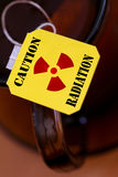 Label with sign radiation. An image of yellow label of tea with sign radiation Stock Image