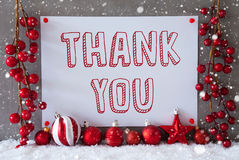 Label, Snowflakes, Christmas Balls, Text Thank You. Label With English Text Thank You. Red Christmas Decoration Like Balls On Snow. Urban And Modern Cement Wall royalty free stock photos