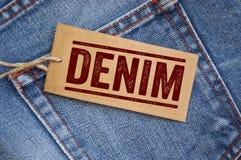 Label sur blues-jean avec le denim photo stock