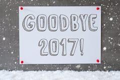 Label sur le mur de ciment, flocons de neige, texte au revoir 2017 Photo libre de droits