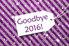 Label sur le papier d'emballage pourpre, flocons de neige, texte au revoir 2016 Images stock