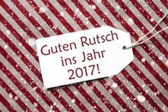 Label sur le papier rouge, flocons de neige, année de moyens de Rutsch 2017 nouvelle Photographie stock libre de droits