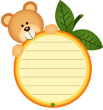 Label with teddy bear eating orange Royalty Free Stock Images
