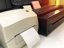 Label themal slip printer and computer destop on cash counter stock photography