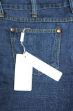 Label tied to the blue jeans Royalty Free Stock Images