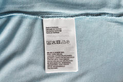 Label with users manual of clothing item Photos stock