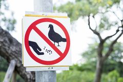 Label warning `Do not feed the birds` Stock Images