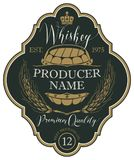 Label for whiskey with ears of barley and barrel. Vector label for whiskey in the figured frame with crown, ears of barley, wooden barrel and handwritten Stock Image