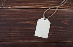 Label on a wooden beige background Royalty Free Stock Photo