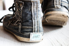 Label with the word start on sneakers. Royalty Free Stock Photo