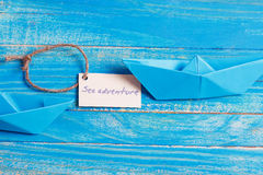 Label with the Words Sea aventure which means go to trip on the yacht Stock Image