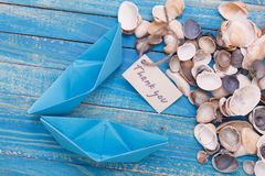 Label with the Words Thank you. Paper Boat with a sign. Label with the Words Sea adventure which means go to trip on the yacht Stock Photos