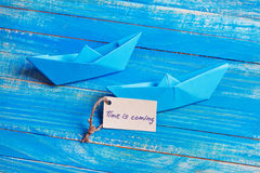 Label with the Words Time is coming. Paper Boat with a sign. Label with the Words Time is coming. Paper Boat with sign Stock Photography