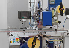 Labeling machine. With conveyor belt in factory Royalty Free Stock Photography