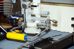Labeling product machine. In food industry Royalty Free Stock Photos