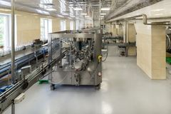 Labeling shop for bottles with drinks. Factory for the production of alcoholic beverages Stock Photo