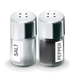Labelled salt and pepper shakers isolated Stock Photography