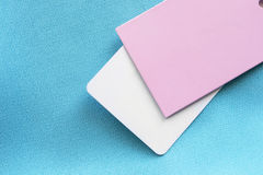 Labels. Blank labels on cyan cloth as a background Stock Photography