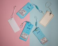 labels from clothes on pink and blue background. stock photo