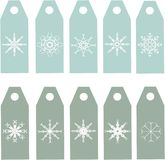 The labels collection. Blue and green labels with white snowflakes Stock Photo