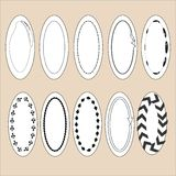 Labels collection. Oval white label with black frames, different patterns Royalty Free Stock Photos